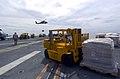 US Navy 050117-N-4142G-036 A Marine drives a forklift filled with supplies aboard the amphibious assault ship USS Bonhomme Richard (LHD 6) during a vertical replenishment.jpg