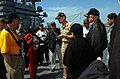 US Navy 050430-N-7711S-038 Commanding Officer, USS Ronald Reagan (CVN 76), Capt. James Symonds, center, escorts members of the Joint Civilian Orientation Conference (JCOC) on a tour of the ship's flight deck.jpg