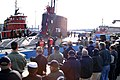 US Navy 051123-N-0653J-001 Friends and family members of Sailors assigned to the attack submarine USS Virginia (SSN 774), applaud as the submarine is moored to its pier.jpg