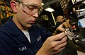 US Navy 051206-N-0685C-001 Aviation Electronics Technician Airman Marty Trojan of Sacramento, Calif., replaces a connector on an infrared receiver.jpg