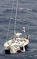 US Navy 060522-N-7949H-005 A sailboat rides low at the bow with torn sails on the main deck and broken rigging.jpg
