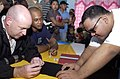 US Navy 060816-N-4104L-015 Senior Chief Hull Technician Carl Hall and Chief Personnel Specialist Bryan Williams are given instructions on how to write in Braille using a stylus and a special template at the Ninos Pag-Asa Center.jpg