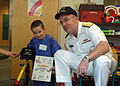 US Navy 060828-N-1805P-012 Chief of Naval Personnel, Vice Adm. John C. Harvey Jr. presents a certificate making a young child an honorary Sailor at Cleveland's Rainbow Babies and Children's Hospital.jpg