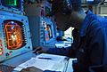 US Navy 070329-N-4124C-011 Operations Specialist Seaman Recruit Louisdes J. Ambroise, attached to Amphibious Squadron (PHIBRON) 11, monitors tracks on a radar screen in the PHIBRON flag plot aboard the amphibious assault ship U.jpg