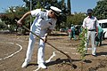 US Navy 070823-N-5142K-075 Capt. James Gregorski, commanding officer of amphibious Assualt Ship USS Kearsarge (LHD 3), shovels some dirt to help plant a tree during a community relations project.jpg