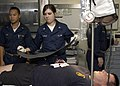 US Navy 070901-N-2564M-017 Hospital Corpsman 3rd Class Kristen Sutherlin, a medical response team member aboard USS Wasp (LHD 1), tends to Navy Diver 1st Class Jeremy Sylvest, of the Norfolk-based Mobile Diving Salvage Unit 2,.jpg