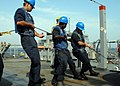 US Navy 090101-N-3392P-089 Line handlers heave line to maintain tension during a replenishment at sea.jpg