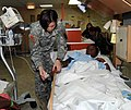 US Navy 090415-A-3007S-005 Pvt. 1st Class Marlise Muenzer, assigned to 807th Medical Command (Deployment Support), checks the vital signs of a Haitian girl after surgery.jpg
