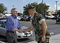 US Navy 091008-N-6889J-001 The Secretary of the Navy (SECNAV) the Honorable Ray Mabus is greeted by Capt. Ed Brown, commanding officer of Naval Construction Battalion Center (NCBC), Commander 20th Seabee Readiness Group (SRG),.jpg