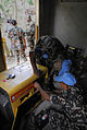US Navy 100211-A-6218H-002 Two Nepal army soldiers repair a diesel generator in an orphanage as their commanding officer and a U.S. Navy Sailor speak with the head matron.jpg