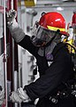 US Navy 100623-N-2013O-012 Machinist's Mate Fireman Carson Pitt, from Daytona, Fla., looks for casualties in a locked space during a general quarters drill aboard the aircraft carrier USS George Washington (CVN 73).jpg