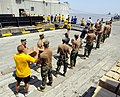 US Navy 100905-N-9643W-144 Sailors, Marines, Airmen and contracted mariners unload 18 pallets of Project Handclasp humanitarian aid supplies to a pier in Guyana.jpg