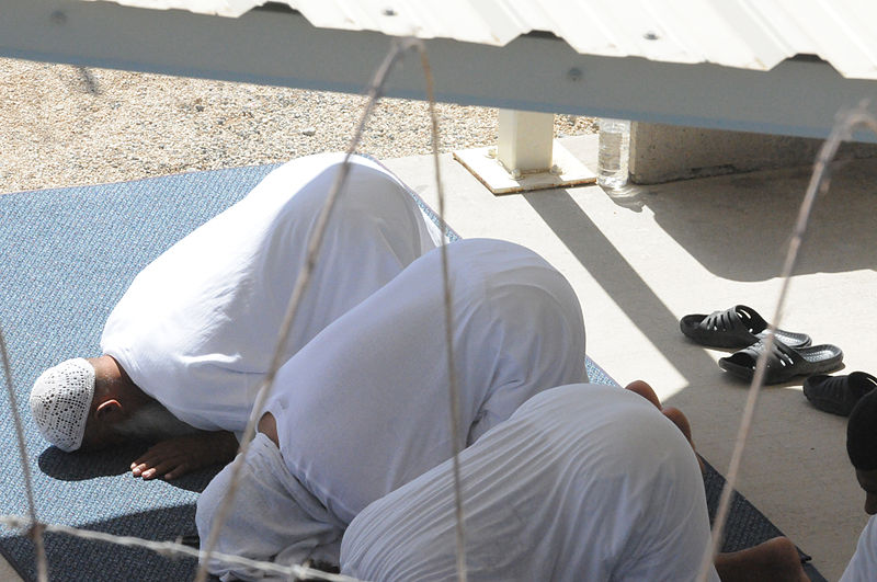 US Navy 101101-F-0651R-041 Detainees pray in the recreation area of Camp Four at Joint Task Force Guantanamo.jpg