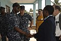 US Navy 110407-N-HI707-747 Cmdr. Darryl Brown is greeted by the director of the Light of Dawn Government Junior Secondary School Tomarow during a c.jpg