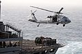US Navy 110519-N-IC111-242 An SH-60F Sea Hawk helicopter assigned to the Wildcards of Helicopter Sea Combat Squadron (HSC) 23 transfers pallets fro.jpg