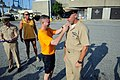 US Navy 110603-N-AD372-509 Master Chief Petty Officer of the Navy (MCPON) Rick D. West pins senior chief anchors on Senior Chief Navy Diver Ty Reno.jpg