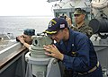 US Navy 110705-N-VY256-046 David Zook, executive officer of the guided-missile destroyer USS Howard (DDG 83) watches U.S. and Philippine navy ships.jpg
