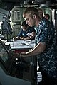 US Navy 110906-N-DX615-025 Seaman Floyd Taylor changes the ship's speed during a strait transit navigation exercise.jpg