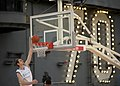 US Navy 111110-N-DR144-460 University of North Carolina basketball player Tyler Zeller dunks during a practice in the basketball arena on the fligh.jpg