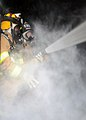 US Navy 111216-N-GT710-004 Navy Region Northwest Fire and Emergency Services Team firefighters conduct a live-fire training exercise inside a mobile.jpg