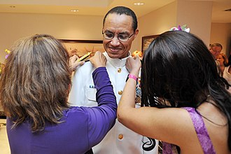 Cecil D. Haney - His family pinning his new shoulder boards