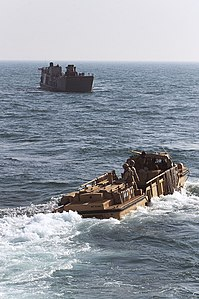 US Navy 120127-N-KS651-231 A landing craft utility and a lighter amphibious re-supply cargo conduct training operations in the wake of the amphibio.jpg