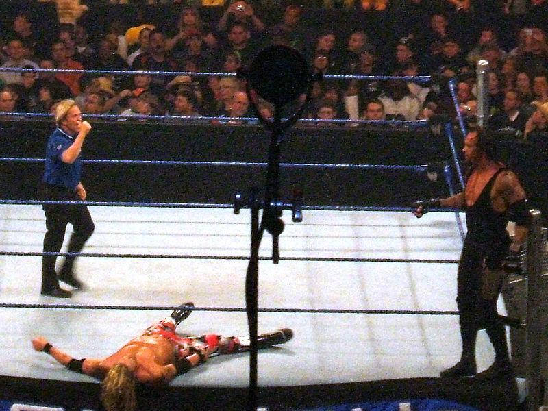 File:Undertaker-Prepares-To-Legdrop-Edge.jpg