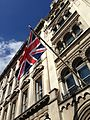 Union Jack flying from a building along Whitehall, London, UK - 20130629.jpg