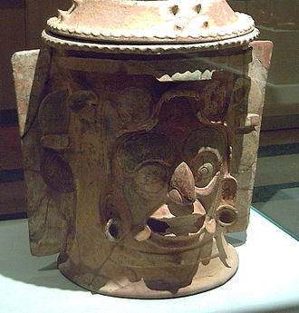 Maya jaguar gods - Jaguar God of Terrestrial Fire on a cinerary urn, Late-Classic period