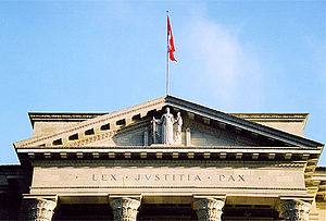 "Justice - Lex, justitia, pax (Latin for ""Law, justice, peace"") on the pediment of the Supreme Court of Switzerland."