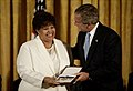 Vera Clemente and George W Bush giving medal.jpg