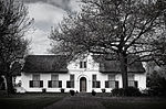 The farm Vredenburg was granted to Hendrik Elbertz in 1691. The historic dwelling thereon was built by a later owner, Jacob Roux, in 1789.
