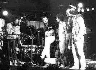 Atilla Engin - World to World Festival 1986. Left to right: Nana Vasconcelos, Birger Sulsbruck, Zakir Hussain, Ahmadu Jarr, and Atilla at the end of Jazzhus Montmartre show.