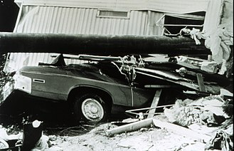 Kelly Barnes Dam - Trailer, vehicle, and utility pole in jumbled pile following the flood, November 7, 1977. From the NOAA Photo Library