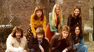 Colored photograph of members of the 70s pop band Pussycat