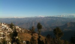 A view of the left half of the Gangotri Group in the Western Himalayas from Pauri, part of which is seen on the left.