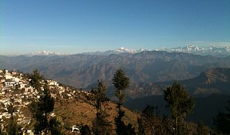 Pauri - A view of the left half of the Gangotri Group in the Western Himalayas from Pauri, part of which is seen on the left.