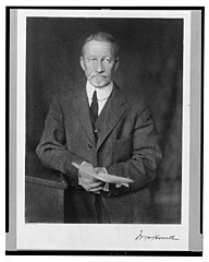William H. Howell, half-length portrait, standing, facing front, leaning on lectern, holding papers LCCN2004669211.jpg