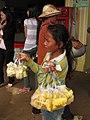 Woman vendor cut pineapple Cambodia.jpg