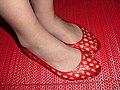 Woman wearing red jelly shoes.jpg
