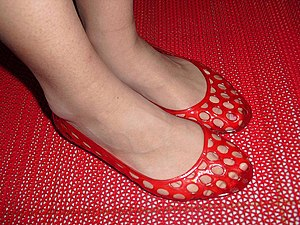 Jelly shoes - A woman wearing jelly shoes