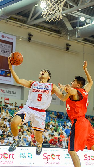 Singapore Slingers - Wong Wei Long (in white) attempts a lay-up.