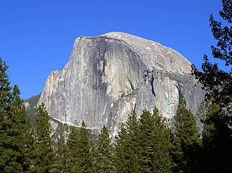 Exfoliation joint - Exfoliation joints have modified the near-surface portions of massive granitic rocks in Yosemite National Park, helping create the many spectacular domes, including Half Dome shown here.