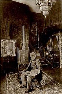 Алексей Алексеевич Харламов в мастерской (1890).jpg