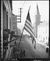 111-SC-202712 - Capt. Thomas H. Garahan, Brooklyn, New York, raises American flag as Bitche, France, falls to the 100th Infantry Division, US Seventh Army, after a siege of many months. He was with the first troops to enter the town.jpg