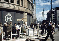 1945 Image of Hattori Tokei-ten building used by GHQ at Ginza 4-chome intersection.jpg