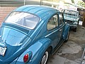 1966 Volkswagen Beetle with 1965 Ford Mustang (48909182411).jpg