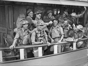 Men wearing military uniforms on board a ferry