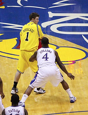 Sherron Collins - Collins guards Stu Douglass of Michigan.