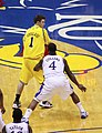 20091219 Stu Douglass guarded by Sherron Collins.jpg